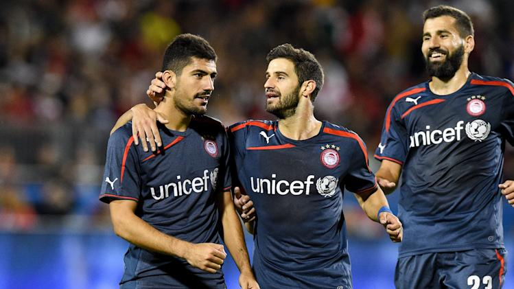 IMAGE DISTRIBUTED FOR GUINNESS INTERNATIONAL CHAMPIONS CUP - Olympiacos midfielder Andreas Bouchalakis (18), Olympiacos defender Tasos Avlonitis (90) and Olympiacos defender Dimitris Siovas (23) celebrate following a goal at Guinness International Cup, on Thursday, July, 24, 2014 at BMO Field in Toronto, Canada. Olympiacos defeated A.C. Milan 3-0. (Mike Janes/AP Images for Guinness International Champions Cup)