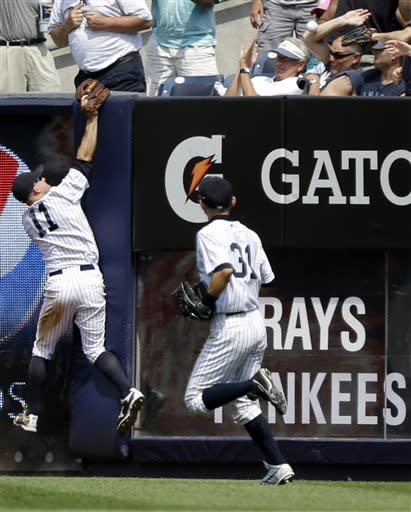 Wells breaks out with big hit, Yanks beat Rays 7-5