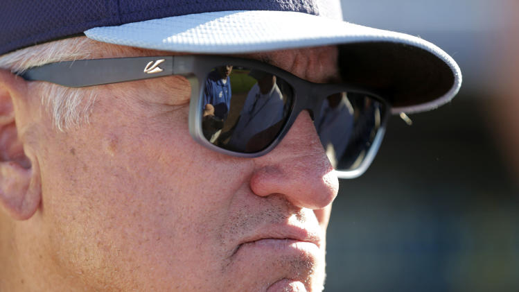 Tampa Bay Rays manager Joe Maddon (70) talks to reporters after an exhibition baseball game against the Pittsburgh Pirates in Port Charlotte, Fla., Saturday, March 8, 2014. (AP Photo/Gerald Herbert)