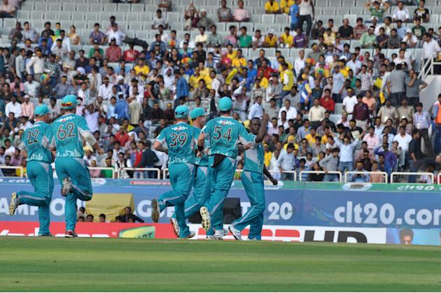 Brisbane Heat playes celebrate after taking a wicket during the Champions League T20, 2nd match, Group B between Brisbane Heat and Trinidad & Tobago at JSCA International Cricket Stadium, Ranchi on Se
