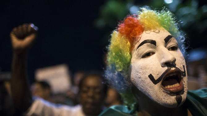A man shouts slogans during a protest outside the home of Sergio Cabral, the governor of Rio de Janeiro state, in Rio de Janeiro, Brazil, Sunday, June 23, 2013. A wave of protests have shaken Brazil and pushed the government to promise a crackdown on corruption and greater spending on social services. (AP Photo/Felipe Dana)