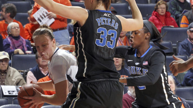 Virginia guard Kelsey Wolfe (10) looks to move the ball around Duke's Haley Peters (33) and Alexis Jones (2) during an NCAA college basketball game Friday, Feb. 8, 2013, in Charlottesville, Va. (AP Photo/Andrew Shurtleff)