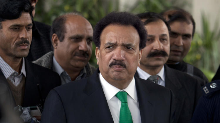 Pakistani Interior Minister Rehman Malik, center, speaks to reporters outside the Supreme Court in Islamabad, Pakistan on Monday, Feb. 4, 2013. Malik said that the government was ready to hold peace talks with domestic Taliban militants who have been waging a bloody insurgency that has killed thousands of people in the country. His comments were the latest sign of growing momentum for talks and followed statements by senior Pakistani Taliban leaders who also indicated they are ready to sit down at the negotiating table. (AP Photo/B.K. Bangash)