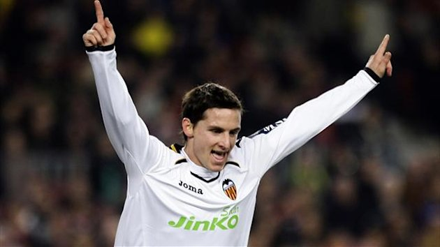 Valencia&#39;s Pablo Piatti celebrates after scoring a goal against Barcelona during their Spanish first division match at Nou Camp stadium