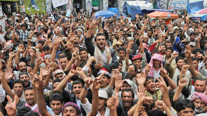 Anti-government protestors shout slogans during a demonstration demanding the resignation of Yemeni President Ali Abdullah Saleh, in Sanaa, Yemen, Wednesday, July 13, 2011. (AP Photo/Mohammed Hamoud)