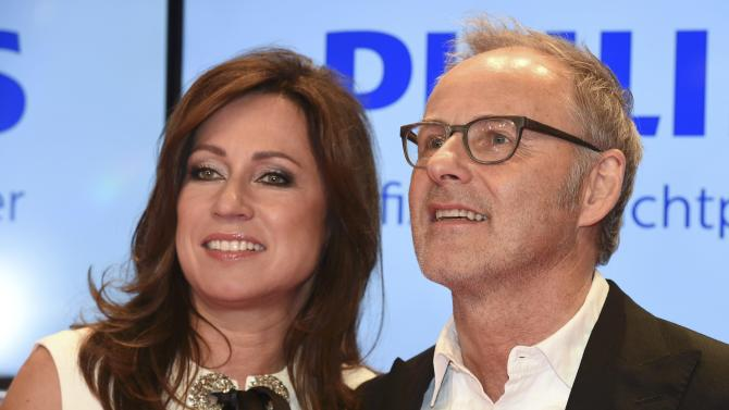 German TV journalist Beckmann and his wife Kerstin pose on the red carpet for the 'Die Goldene Kamera' (Golden Camera) awards ceremony in Hamburg