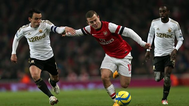 Arsene Wenger lauded Jack Wilshere, centre, for his performance against Swansea