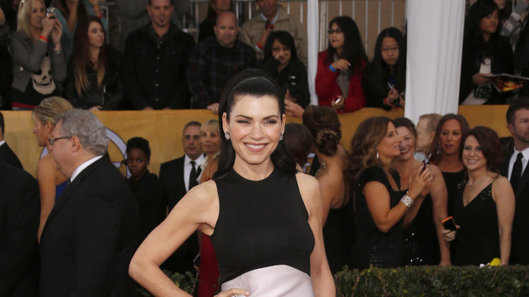Julianna Margulies arrives at the 19th Annual Screen Actors Guild Awards at the Shrine Auditorium in Los Angeles on Sunday Jan. 27, 2013. (Photo by Todd Williamson/Invision for The Hollywood Reporter/AP Images)
