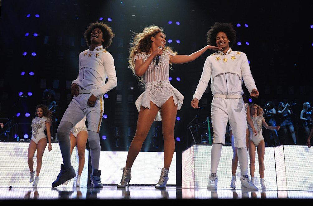 "IMAGE DISTRIBUTED FOR PARKWOOD ENTERTAINMENT - Singer Beyonce performs on her ""Mrs. Carter Show World Tour 2013"", during the BET Experience music festival on Friday June 28, 2013, in Los Angeles. Beyonce is wearing a custom hand beaded peplum one-piece by Ralph & Russo with shoes by Stuart Wieztman. (Photo by Frank Micelotta/Invision for Parkwood Entertainment/AP Images)"