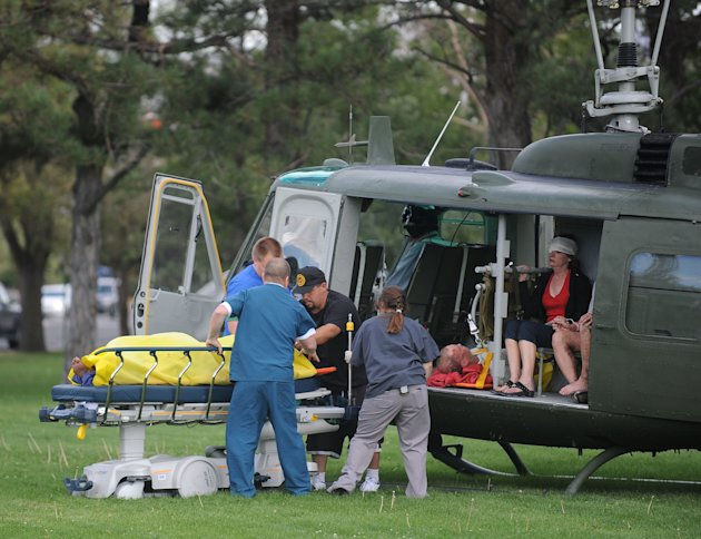 Medics help injured bystanders out of a helicopter into Renown Medical Center after a plane crashed into the crowd at the Reno National Championship Air Races, Friday, Sept. 16, 2011,  in Reno, Nev. A