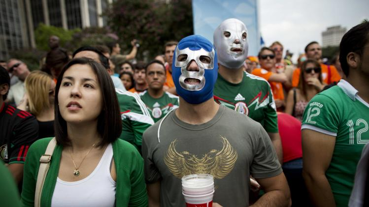 Fans of the Mexican national soccer team watch as their team battles the Netherlands in the World Cup round of 16 match on a live telecast inside the FIFA Fan Fest area during the 2014 soccer World Cup in Sao Paulo, Brazil, Sunday, June 29, 2014. The Netherlands staged a dramatic late comeback, scoring two goals in the dying minutes to beat Mexico 2-1 and advance to the World Cup quarterfinals. (AP Photo/Rodrigo Abd)