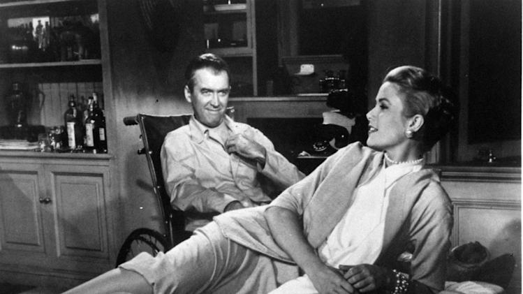 "FILE - This 1954 file photo released by Paramount Pictures shows Jimmy Stewart, left, and Grace Kelly in Alfred Hitchcock's film, ""Rear Window.""  A producing team has won the theatrical stage rights to ""Rear Window,"" the noir tale that Alfred Hitchcock made into a classic film. Producer Charlie Lyons, director Jay Russell and actor Tim Guinee announced Wednesday, Oct. 24, 2012, that their two-year hunt for the rights have been successful and they're hoping to mount the show on Broadway. The film version, starring Stewart and Kelly, tells the story of a wheelchair-bound witness to a possible murder.  (AP Photo/Paramount Pictures, file)"