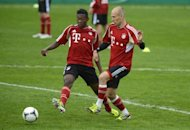 Bayern Munich's Arjen Robben (R) and David Alaba during a training session on May 11. Bayern are out to break their losing streak to German champions Borussia Dortmund in Saturday's domestic cup final as their Champions League showdown with Chelsea looms