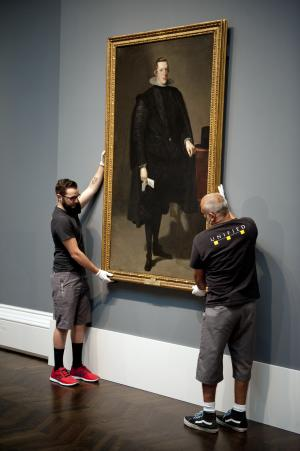 This handout photo courtesy of the Meadows Museum shows workers installing a full-length portrait of Spain's King Philip IV at the Meadows Museum on the campus of Southern Methodist University in Dallas, on Thursday, Sept. 13, 2012. The painting is on loan from Spain's Prado for an exhibit at the Meadows opening Sunday. The exhibit is part of a partnership between the Meadows and Madrid's famed Prado. (AP Photo/Meadows Museum, Hillsman S. Jackson)