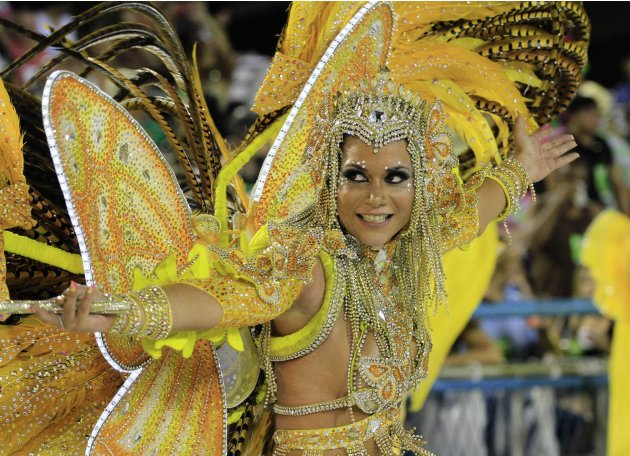 A reveller from the Sao Clemente samba school takes part in the parade on the second night of the annual Carnival parade in Rio de Janeiro's Sambadrome