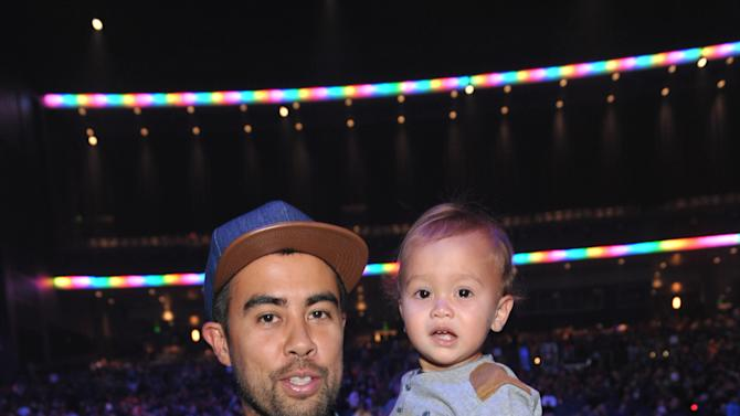 Eric Koston and son attends Yo Gabba Gabba! Live!: Get The Sillies Out! 50+ city tour kick-off performance on Thanksgiving weekend at Nokia Theatre L.A. Live on Friday Nov. 23, 2012 in Los Angeles. (Photo by John Shearer/Invision for GabbaCaDabra, LLC./AP Images)