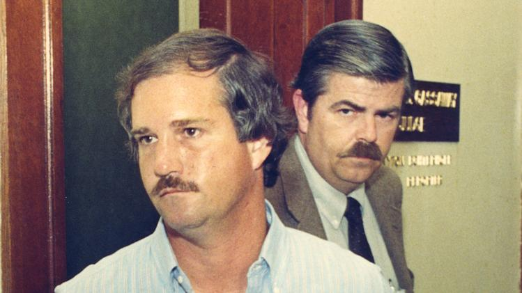 In this 1987 photo, Ed Graf is led away from judge's chambers by Hewitt police detective Frank Latham in Waco, Texas.  Graf, convicted of setting a fire that killed his two stepsons a quarter-century ago,  has been granted a new trial.  The Texas Court of Criminal Appeals on Wednesday, March 27, 2013,  ordered Graf's 1988 murder conviction set aside, pending a new trial. Graf was convicted of locking his stepsons in a shed and setting it on fire in Hewitt, Texas, in 1986. Two fire investigators then said the fire was arson. Experts now say that investigation was flawed and the fire could have been accidental. (AP Photo/Waco Tribune Herald, Steve Earley)