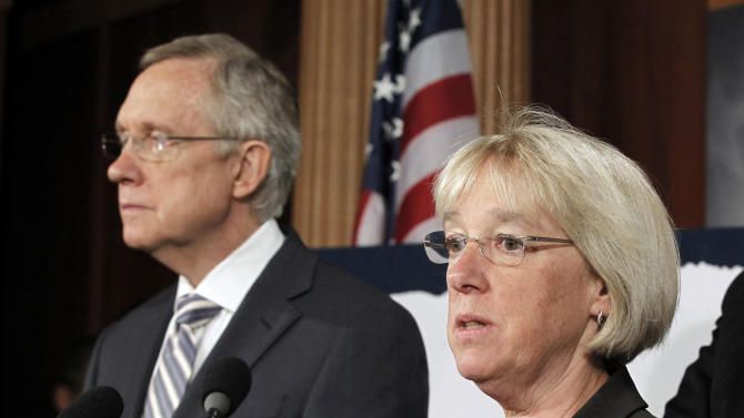 """FILE - In this July 27, 2011, file photo, Sen. Patty Murray, D-Wash.,  speaks as Senate Majority Leader Harry Reid listens at a news conference on Capitol Hill in Washington. Reid announced Tuesday, Aug. 9, 2011, he's naming to co-chair a powerful """"super committee"""" charged with finding more than $1 trillion in deficit cuts this fall. Murray will be joined by Sens. John Kerry, D-Mass., and Max Baucus, D-Mont., on the panel, which was established last week by hard-fought legislation to increase the national debt. (AP Photo/J. Scott Applewhite)"""