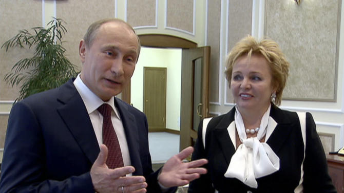 """In this grab made from video provided by the Russia24 TV Channel on Thursday, June 6, 2013, Russian President Vladimir Putin, left, and his wife Lyudmila speak to journalists after attending the ballet """"La Esmeralda"""" in the Kremlin Palace in Moscow, Russia. Russian President Vladimir Putin and his wife Lyudmila said Thursday they are divorcing after nearly 30 years of marriage, making the announcement on state television after attending a ballet performance at the Kremlin. (AP Photo/Russia24 via The Associated Press Television News) TV OUT"""