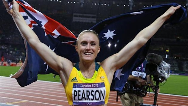 Australia's Sally Pearson holds her national flag after winning the women's 100m hurdles final during the London 2012 Olympic Games at the Olympic Stadium August 7, 2012.