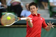 Asia's top player Kei Nishikori (pictured) of Japan will face a tough fight in the ATP Tour's Malaysian Open which begins on Monday. Nishikori, the third seed for the event at the Putra Stadium in Kuala Lumpur, is headed in draw by the in-form world number five and top seed David Ferrer of Spain and world number 11 Juan Monaco from Argentina, the second seed