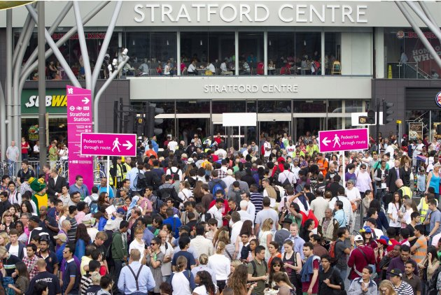 People queue to get into the Olympic Park for the opening ceremony of the 2012 Olympic Games, at Stratford Station in London