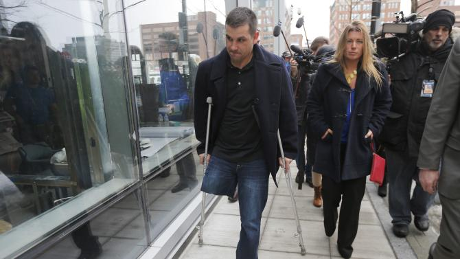 Boston Marathon bombing survivor Marc Fucarile leaves the federal courthouse on the first day of the trial of accused bomber Dzhokhar Tsarnaev in Boston