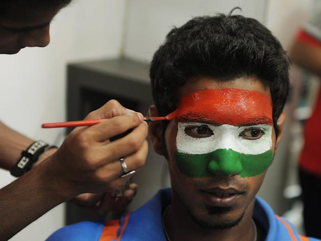An Indian Hairdresser paints the Indian