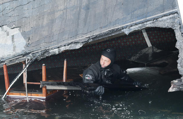 In this undated photo released by the Italian Navy Tuesday, Jan. 24, 2012, a scuba diver makes his way into a flooded cabin of the Costa Concordia cruise ship grounded off the Tuscan island of Giglio,