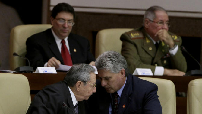 Cuba's new Vice President Miguel Diaz-Canel, right, and Cuba's President Raul Castro, talk during the closing session at the National Assembly in Havana, Cuba, Sunday, Feb. 24, 2012. Castro accepted a new five-year term that will be, he said, his last as Cuba's president and tapped rising star Diaz-Canel, 52, as vice-president and first in the line of succession. Diaz-Canel has risen higher than any other Cuban official who didn't directly participate in the 1959 Cuban revolution. (AP Photo/Ismael Francisco, Cubadebate)