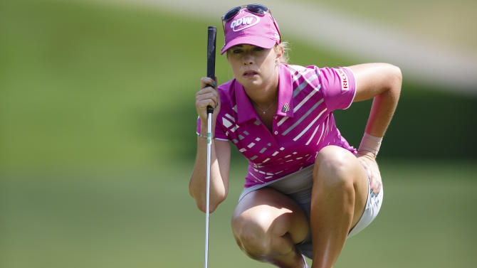 Paula Creamer lines up her putt on the 18th green during the third round of the Marathon Classic golf tournament at Highland Meadows Golf Club in Sylvania, Ohio, Saturday, July 20, 2013. (AP Photo/Rick Osentoski)