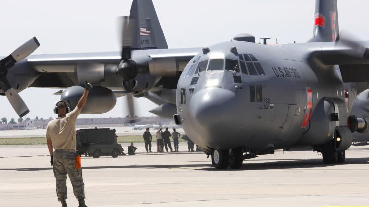 A Modular Airborne Firefighting System-equipped C-130 Hercules aircraft from the Air Force Reserve's 302nd Airlift Wing prepare to take flight at Peterson Air Force Base
