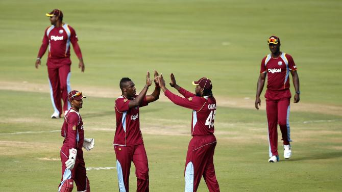Andre Russell of the West Indies celebrates with team mates after bowling out South Africa's Faf du Plessis during the fifth one-day international (ODI) in Centurion
