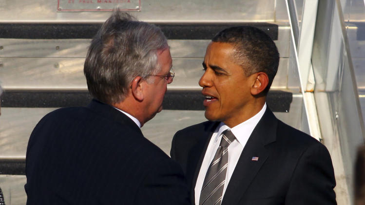 Missouri Gov. Jay Nixon, left, greets President Barack Obama at Joplin Municipal Airport in Joplin, Mo., Monday, May 21, 2012.  (AP Photo/Mark Schiefelbein)