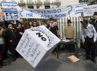 "People gathered in a protest against the Eurovegas project in Madrid, Spain, Saturday, March 17, 2012. Poster reads ""Welcome Mister Adelson?"", ""Eurovegas no!"", ""Labor reform is Eurovegas"", ""Eurovegas shows the country what the Popular Party wants"", ""Vulnerability of the children"", ""Prostitution"", ""Gambling addiction"" and ""Criminality"". Eurovegas is a U.S. billionaire's proposal that promises to build six casinos, 12 hotels and create jobs in a country on the brink of its second recession in four years and an unemployment rate near 23%. Madrid has been selected by Sheldon Adelson, 78, and his company Las Vegas Sands to be the site of Eurovegas, a project which protesters say would cost Spain more in grants, concessions and problems than it would yield benefits. (AP Photo/Andres Kudacki)"