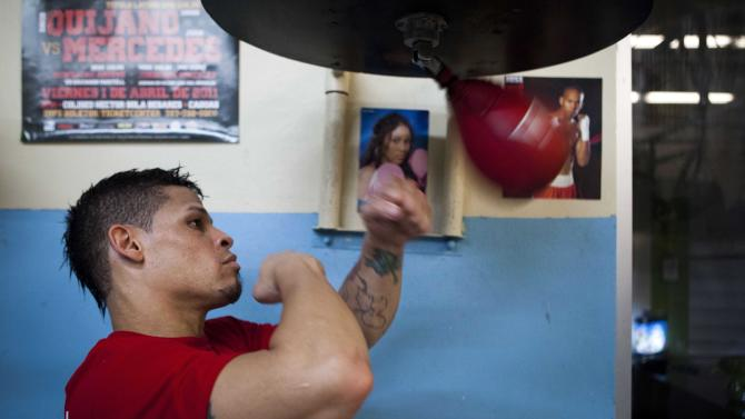 "Boxer Orlando Cruz hits the speed bag while posing for pictures after a training session at a public gym in San Juan, Puerto Rico, Thursday, Oct. 4, 2012. Describing himself as ""a proud gay man"", Puerto Rican featherweight Orlando Cruz on Thursday became what is believed to be the first pro boxer to come out as openly homosexual while still competing. (AP Photo/Dennis M. Rivera Pichardo)"