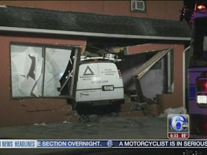 Van crashes into building, driver faces DUI charges