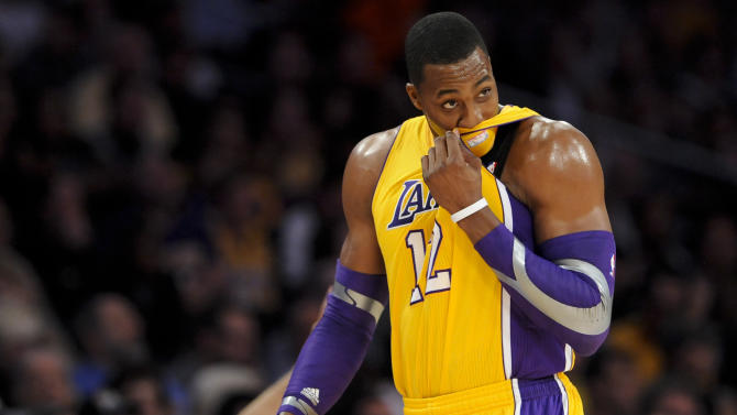 Los Angeles Lakers center Dwight Howard looks on as he leaves the court in the first half of an NBA basketball game against the Los Angeles Clippers, Friday, Nov. 2, 2012, in Los Angeles.(AP Photo/Gus Ruelas)
