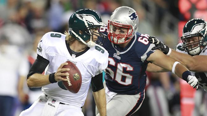 New England Patriots defensive end Jake Bequette (66) chases Philadelphia Eagles quarterback Nick Foles (9) during the second quarter of an NFL preseason football game in Foxborough, Mass., Monday, Aug. 20, 2012.(AP Photo/Steven Senne)