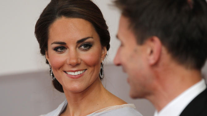 Kate, Duchess of Cambridge talks to Culture Secretary Jeremy Hunt as she leaves the Royal Academy of Arts in London after attending the UK creative industries reception hosted by the British Government supported by the Founders Forum, Monday, July 30, 2012. (AP Photo/Sang Tan)