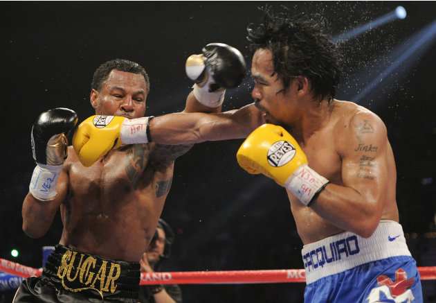 Shane Mosley, left, and Manny Pacquiao exchange punches in the sixth round during a WBO welterweight title bout, Saturday, May 7, 2011, in Las Vegas.  (AP Photo/Mark Terrill)