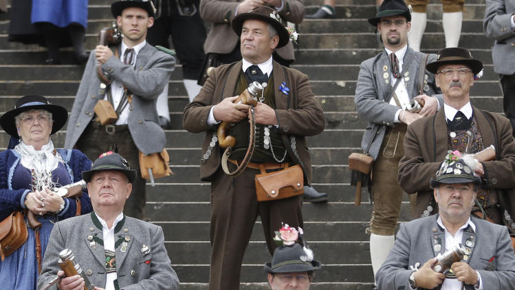 A Bavarian riflemen in traditional costume awaits to fire his muzzle loader in Munich, southern Germany, Sunday, Oct. 7, 2012. Members of various shooting clubs of the region met for a salute on the last day of the famous Oktoberfest beer festival. (AP Photo/Matthias Schrader)