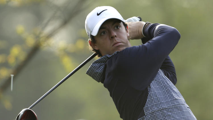 Rory McIlroy, of Northern Ireland, watches his tee shot on the 11th hole during the second round of the Wells Fargo Championship golf tournament at Quail Hollow Club in Charlotte, N.C., Friday, May 3, 2013. (AP Photo/Chuck Burton)