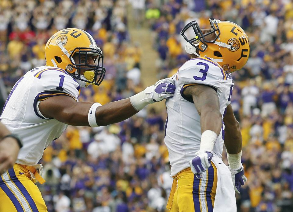 LSU wide receiver Odell Beckham (3) celebrates with safety Eric Reid after Beckham scored on a punt return againtst North Texas during the first half of an NCAA college football game in Baton Rouge, La., Saturday, Sept. 1, 2012.  (AP Photo/Bill Haber)