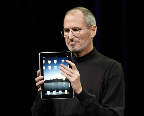 FILE - In this Jan. 27, 2010 file photo, Apple CEO Steve Jobs shows off the new iPad during an event in San Francisco. Imagine the potential treasures inside the stolen iPad of the late Steve Jobs, secret corporate documents, personal correspondence and maybe even game prototypes. Professional entertainer Kenny the Clown, who unwittingly received the stolen tablet after the Apple co-founders Palo Alto home was burglarized last month, says he never examined the touch-screen devices contents. The San Jose Mercury News says Kenny the Clown, whose real name is Kenneth Kahn, had no idea the iPad came from the Jobs residence until a friend who gave it to him was charged with burglary and police had confiscated the device. Authorities say 35-year-old Kariem McFarlin stole iPods, Macs, jewelry and Jobs wallet. He is due in court Monday and recently hired a lawyer. (AP Photo/Paul Sakuma, File)