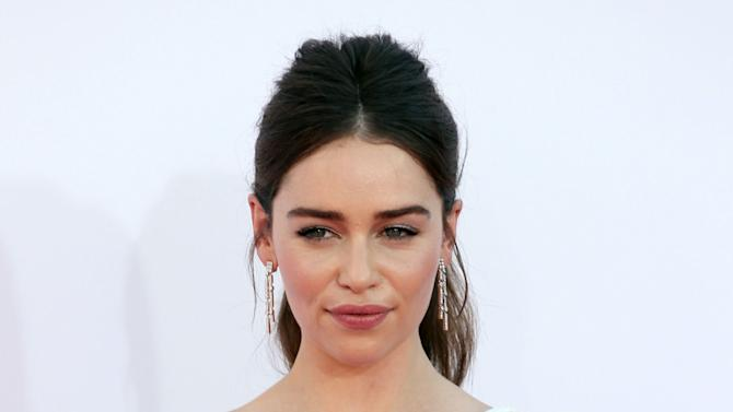 """FILE - This Sept. 23, 2012 file photo shows Emilia Clarke from """"Game of Thrones"""" arriving at the 64th Primetime Emmy Awards at the Nokia Theatre in Los Angeles. Producers said Wednesday that a new adaptation of """"Breakfast at Tiffany's"""" is aiming for a Shubert theater in New York City in February 2013. The stage adaption of Truman Capote's classic novella will star Emilia Clarke of HBO's """"Game of Thrones"""" as Golightly, a role Audrey Hepburn played in the 1961 movie. (Photo by Matt Sayles/Invision/AP, file)"""