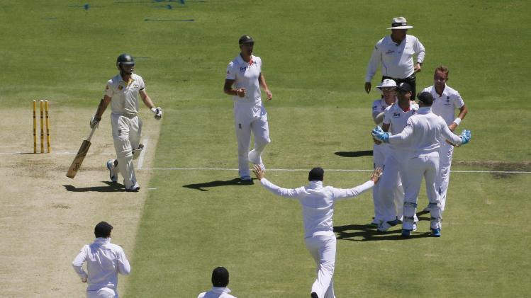 England's players celebrate after the running out of Australia's Rogers during the first day's play of the third Ashes cricket test match at the WACA in Perth