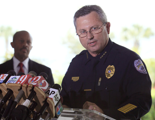 FILE - In this March 22, 2012 file photo, Sanford Police Chief Bill Lee speaks to the the media during a news conference as city manager Norton Bonaparte Jr. listens at left, in Sanford Fla. Lee, who was strongly criticized for his agency's initial investigation of Trayvon Martin's slaying, was fired Wednesday, June 20, 2012, city officials said. (AP Photo/Julie Fletcher, File)