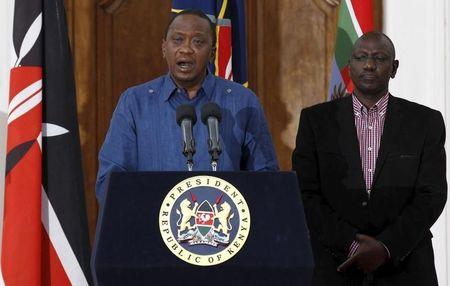 Kenyan President Uhuru Kenyatta, flanked by his Deputy William Ruto, addresses a news conference at the State House in Nairobi