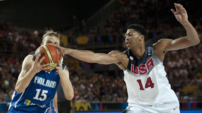 United States's Anthony Davis, right,  duels for the ball beside Finland's Antero Lehto, during the Group C Basketball World Cup match between United States and Finland,  in Bilbao northern Spain, Saturday, Aug. 30, 2014. The 2014 Basketball World Cup competition will take place in various cities in Spain from Aug. 30 through to Sept. 14